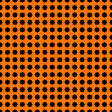 Seamless pattern with stylezed black ink spots on orange background. Halloween design concept digital paper. Royalty Free Stock Photos