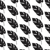 Seamless pattern with stylish palm leaves. Graphically natural print. Royalty Free Stock Photo