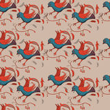 Seamless pattern with stylized birds in ethnic style Royalty Free Stock Images