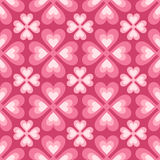 Seamless pattern of stylized flowers and hearts Stock Images