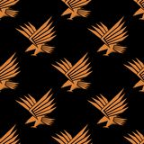 Seamless pattern of a stylized flying eagle Stock Photography