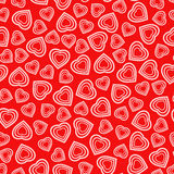 Seamless pattern with stylized heart symbol. Romantic wallpaper. Royalty Free Stock Images