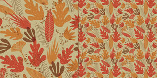 Seamless pattern of stylized leaves, branches and flowers. Royalty Free Stock Images