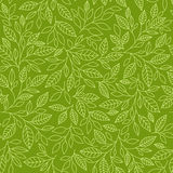 Seamless pattern with stylized leaves. On a green background Royalty Free Stock Photography