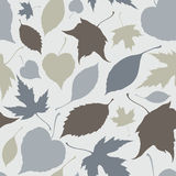 Seamless pattern with stylized silhouette leaves Royalty Free Stock Photo
