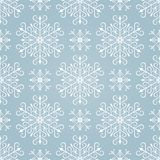Seamless pattern with stylized snowflakes. Royalty Free Stock Photography