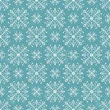 Seamless pattern with stylized snowflakes. Royalty Free Stock Image