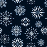 Seamless pattern with stylized snowflakes. Endless winter texture Royalty Free Stock Photo