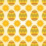Seamless pattern of yellow easter eggs with sunny flowers. Seamless pattern of sunflower and yellow easter eggs with colorful pattern of waves and lights Royalty Free Stock Photo