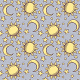Seamless pattern with suns, moons and stars. Stock Image