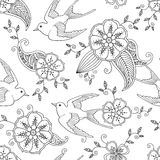 Seamless pattern with swallow bird flying and floral motif hand drawn Stock Photo