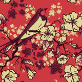 Seamless pattern with swallow sitting on blooming tree branches Stock Photography