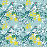 Seamless pattern with swallow sitting on blooming tree branches Stock Image