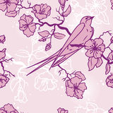 Seamless pattern with swallow sitting on blooming tree branches. Vector illustration Stock Photo