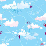 Seamless pattern with swallows, hearts and clouds  Stock Image
