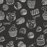 Seamless pattern with sweet cakes and candy on a black background Stock Images