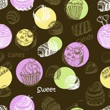 Seamless pattern with sweet cakes and candy on a dark background Stock Photos