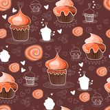 Seamless pattern with sweet cupcakes on chocolate background. Royalty Free Stock Photo