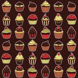 Seamless pattern with sweet cupcakes. Vector seamless texture for wallpapers, pattern fills, web page backgrounds Stock Photos