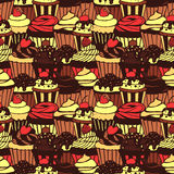 Seamless pattern with sweet cupcakes. Vector seamless texture for wallpapers, pattern fills, web page backgrounds Royalty Free Stock Photos