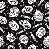 Seamless pattern with sweets and desserts. Black background. Seamless pattern with sweets and desserts: cupcake,donut, pretzel. Cartoon style vector. Baked goods royalty free illustration