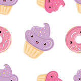 Seamless pattern with sweets - donuts, cupcakes isolated on white background. Royalty Free Stock Photo