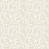Seamless pattern of swirls on a light beige background. Stock Image