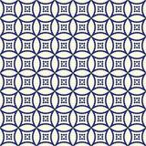 Seamless pattern with symmetric geometric ornament. Abstract repeated circles background. Ethnic wallpaper. Royalty Free Stock Images