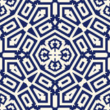 Seamless pattern with symmetric geometric ornament. Navy color abstract background. Royalty Free Stock Photos