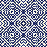 Seamless pattern with symmetric geometric ornament. Navy color abstract background. Stock Photos