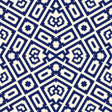 Seamless pattern with symmetric geometric ornament. Navy color abstract background. Stock Images