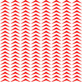 Seamless pattern with symmetric geometric ornament. Repeated stylized red triangles on white background. Zigzag motif. Royalty Free Stock Image