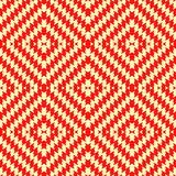 Seamless pattern with symmetric wavy rhombuses ornament. Red color jagged stripes on yellow background. Aztec motif. Stock Image