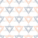 Seamless  pattern. Symmetrical geometric background with red and blue triangles in the shape of stars on the white backdrop. Stock Image