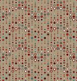 Seamless pattern on a tan background. Has the shape of a wave. Consists of geometric elements of round shape in color. Useful as design element for texture Royalty Free Stock Photography