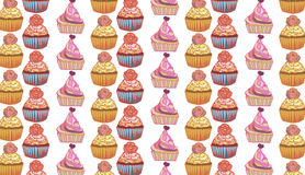 Seamless pattern with tasty cup cakes in soft colors Stock Image