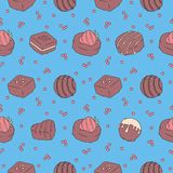 Seamless pattern with tasty looking chocolate pralines on bright blue background vector illustration