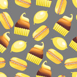 Seamless pattern with tasty macaroons, cupcake, cake and lemon Stock Photo