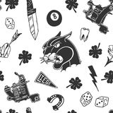 Seamless pattern with traditional tattoo designs: dice, clover, knife, lightning bolt, panther, tattoo machine, tooth, snake, hors Stock Photos