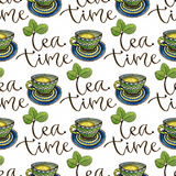 Seamless pattern with tea cups and calligraphy decoration. Watercolor texture for menu or wrapping design. Seamless pattern with tea cups and calligraphy Royalty Free Stock Photo