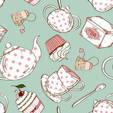 Seamless pattern of tea set and cupcakes Royalty Free Stock Image