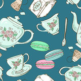 Seamless pattern of tea set and French macaroons Royalty Free Stock Photography