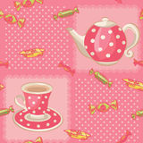 Seamless pattern with tea set. Pink dotted background and teapot, cup with sweets. Colorful vector illustration Stock Photo