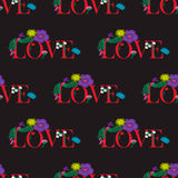 Seamless pattern with text love and flowers Stock Photos