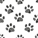 Seamless pattern for textile design. Black and white paw print pattern stock illustration