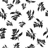 A seamless pattern texture of black carved leaves stock illustration
