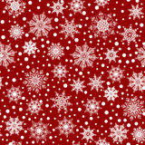 Seamless pattern, texture with white snowflakes and snow on red background Stock Images