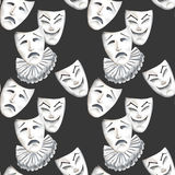 Seamless pattern with theater masks of laughter and sadness emotions. Hand drawn on a black background Stock Image