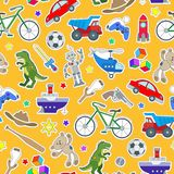 Seamless illustration on the theme of childhood and toys, toys for boys, patch icons on orange background. Seamless pattern on the theme of childhood and toys Royalty Free Stock Images