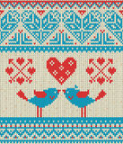 Seamless pattern on the theme of holiday Valentine`s Day with an image of the Norwegian and fairisle patterns. Heart, birds in a k Stock Photography